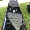 Overview of canoe with seat, netting and foot well system.